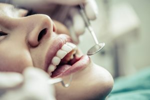 Dentist treating patient teeth