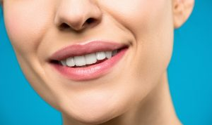 female smiling with healthy white teeth,
